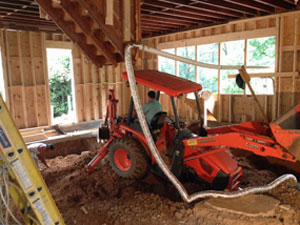 Excavating floor of Carriage House